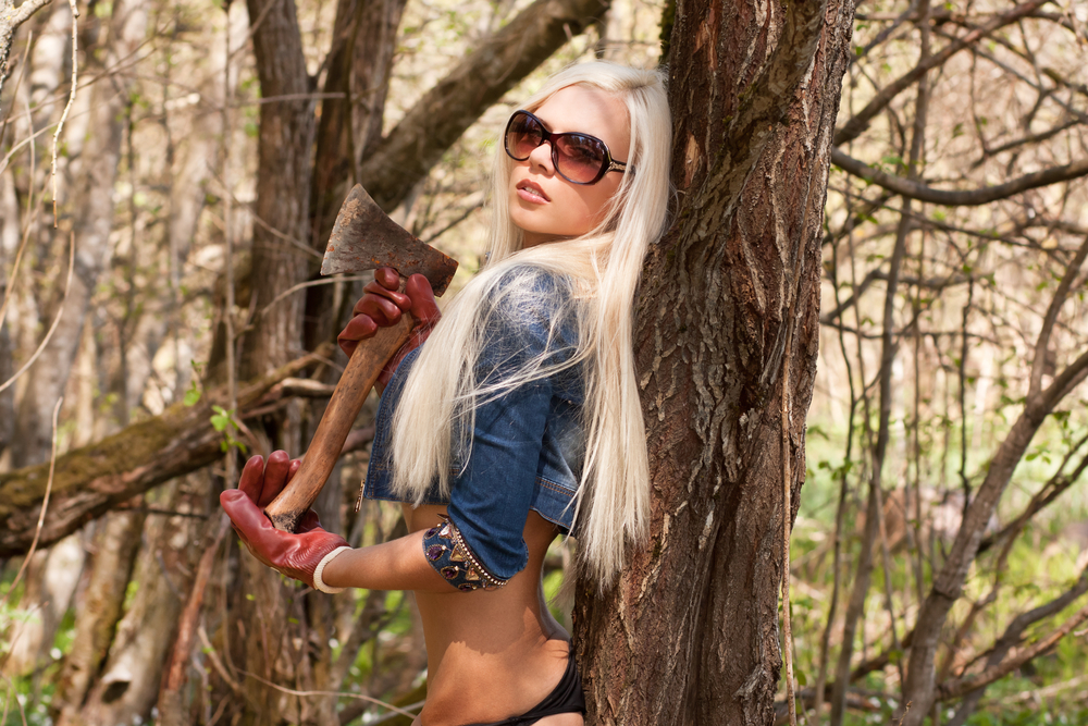 blonde with axe - shutterstock_141067222